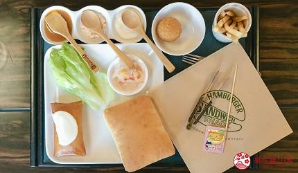 北海道道东四天三夜推荐行程的「双叶寿司」的干贝汉堡与沾酱